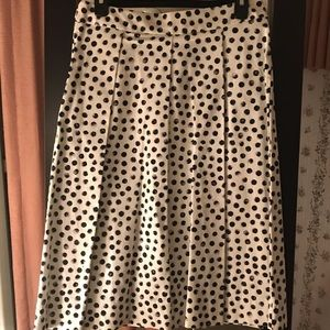 White skirt with black and gray polka dots
